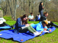 Students in the new environmental art class study, draw, and improve their surroundings