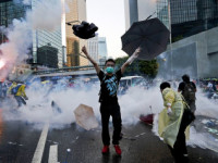 A  young demonstrator in Hong Kong protests Beijing's involvement in Hong Kong elections.