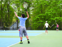 Boys' Thirds Tennis players practice their stellar skills at an afternoon practice at the Hunt Tennis Center.
