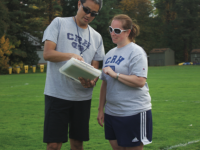 The girls' thirds soccer coaches strategize on Ayres field.