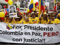 Colombian citizens protest their government's peace talks with the FARC, concerned with the small amount of criminals brought justice