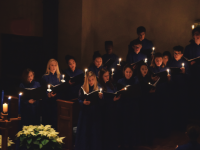 Clothed in blue robes, choral students perform for an excited audience.. Andrew Garver / The Choate News.