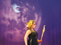 Under Circe's gaze, Pallas Athena (played by Rebecca Lilenbaum '17) glides across the stage during The Odyssey. Athena is the goddess of wisdom and war strategy, and she supports Odysseus on his journey home.