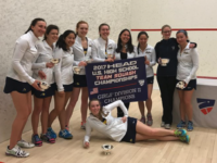 The Girls' Squash Team poses after triumph in the Division II National Championships.