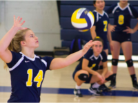 With her teammates looking on, Blake Migden '19 serves during a seven-hour, three-game Saturday.