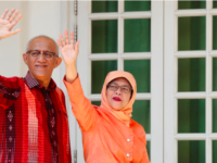 President of Singapore Halimah Yacob and her husband wave to supporters in September 2017.