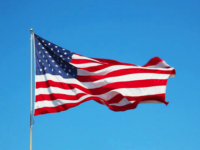 The American flag waves in the wind, honoring those who died on September 11, 2001.