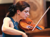 Violin teacher Ms. Artemis T. Simerson performed a beautiful violin solo during the concert last Sunday.