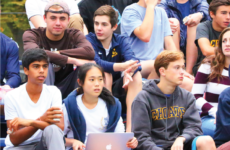 "Choate students ""cheer on"" the football team at a home game."