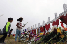 Two children visit a memorial for the victims of the Sutherland Spring shooting at a church in Sutherland Springs, Texas.