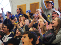 The Choate fan section cheers on Girls Varsity Volleyball on Deerfield Day.