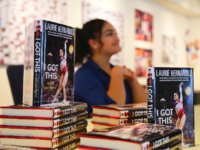 Laurie Hernandez signing copies of her book, I Got This, after School Meeting.