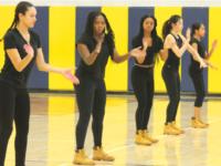 Step Squad leaders Zara Harding, Donessa Colley, Shamari Harrington, and Tiffany Lin lead a dance in their classic ensemble.