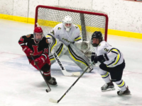 Defenseman Kyle Sanborn '19 and goaltender Jackson Elkins '18 follow a puck out of the zone.
