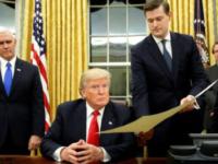 Former White House Staff Secretary Rob Porter hands a document to President Donald Trump P'00.
