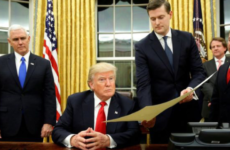 Former White House Staff Secretary Rob Porter hands a document to President Donald Trump P'00.