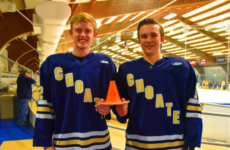 Boys' JV Hockey Co-Captains John Burt '18 and Ian Merrick '18 with the Grim Cup.